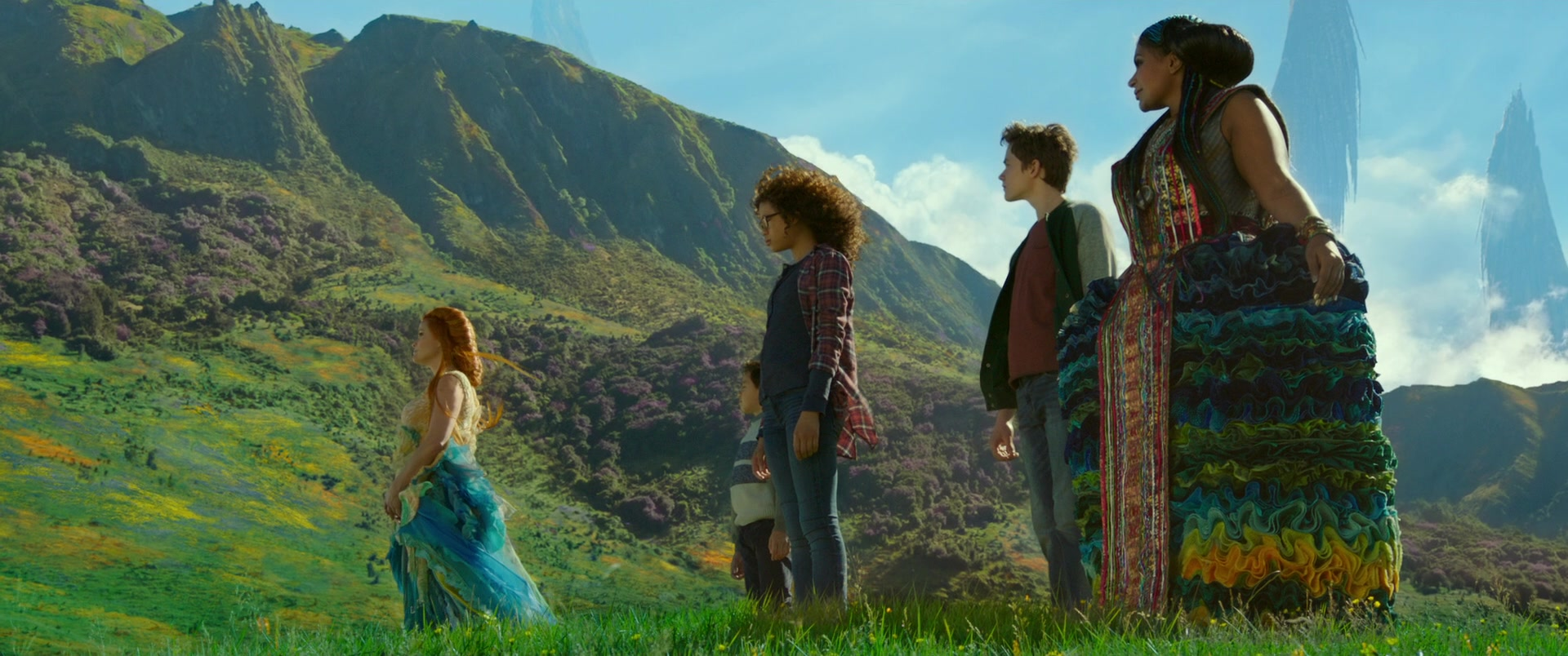 screencap from a wrinkle in time movie with characters standing in a field facing left